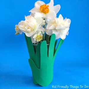 Making A Grass Child's Handprint Vase - This is so sweet. A great container for flowers to give on Mother's Day or Teacher Gift - KidFriendlyThingsTodo.com