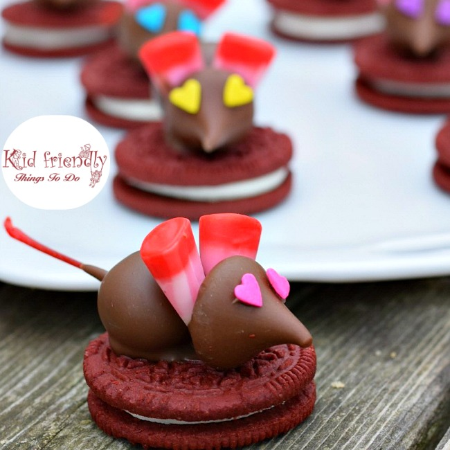 Chocolate Covered Cherry Valentine Mice On A Red Velvet Cookie for a kids fun food treat - www.kidfriendlythingstodo.com