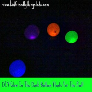 glow in the dark balloons in a swimming pool at night
