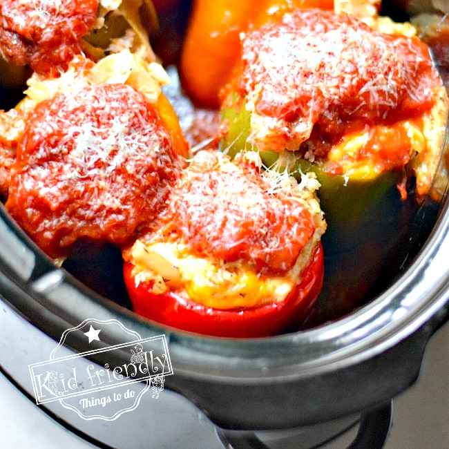 The BEST Healthy Slow Cooker Vegetable Stuffed Peppers Made with rice and beans. Perfect for a family dinner. www.kidfriendlythingstodo.com