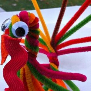 Pipe Cleaner Turkey Treat Holder and Craft for Thanksgiving - KidFriendlyThingsToDo.com