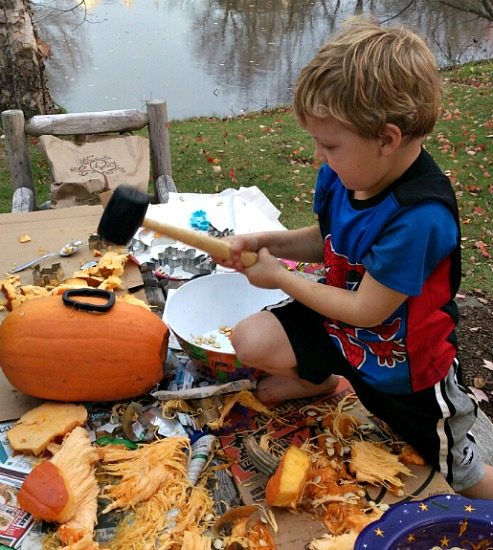 Carving Jack-o-Lanterns the easy way, with cookie cutters and a rubber mallet!