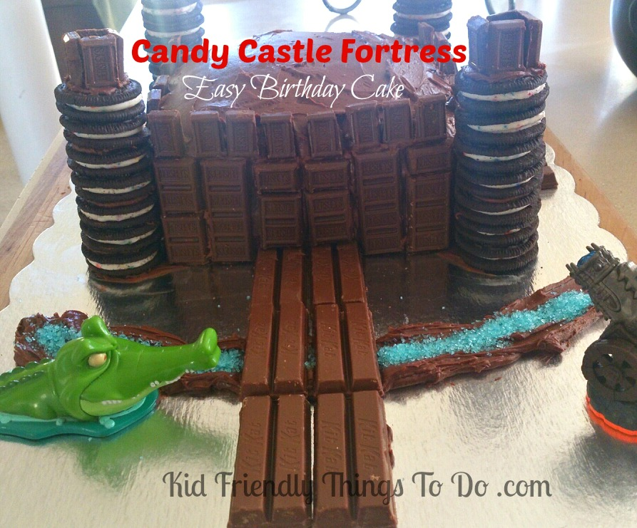 A Candy Castle Fortress Birthday Cake Decorated With Hershey Bars