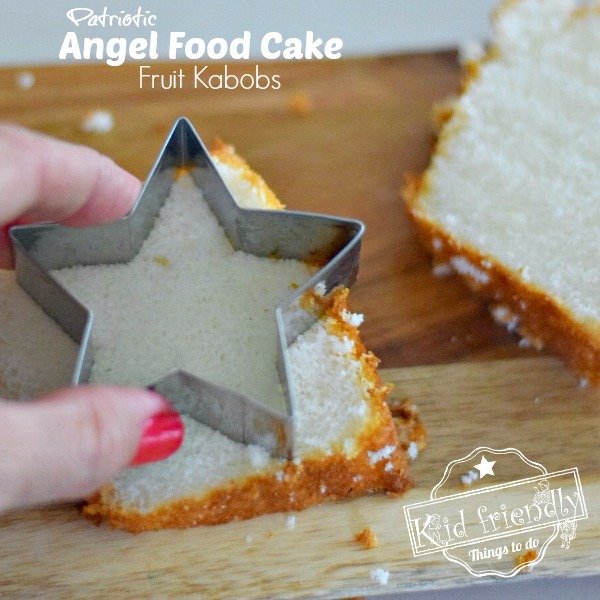 Cutting a Star shaped angel food cake topper for Fruit Sparkler Patriotic Treats