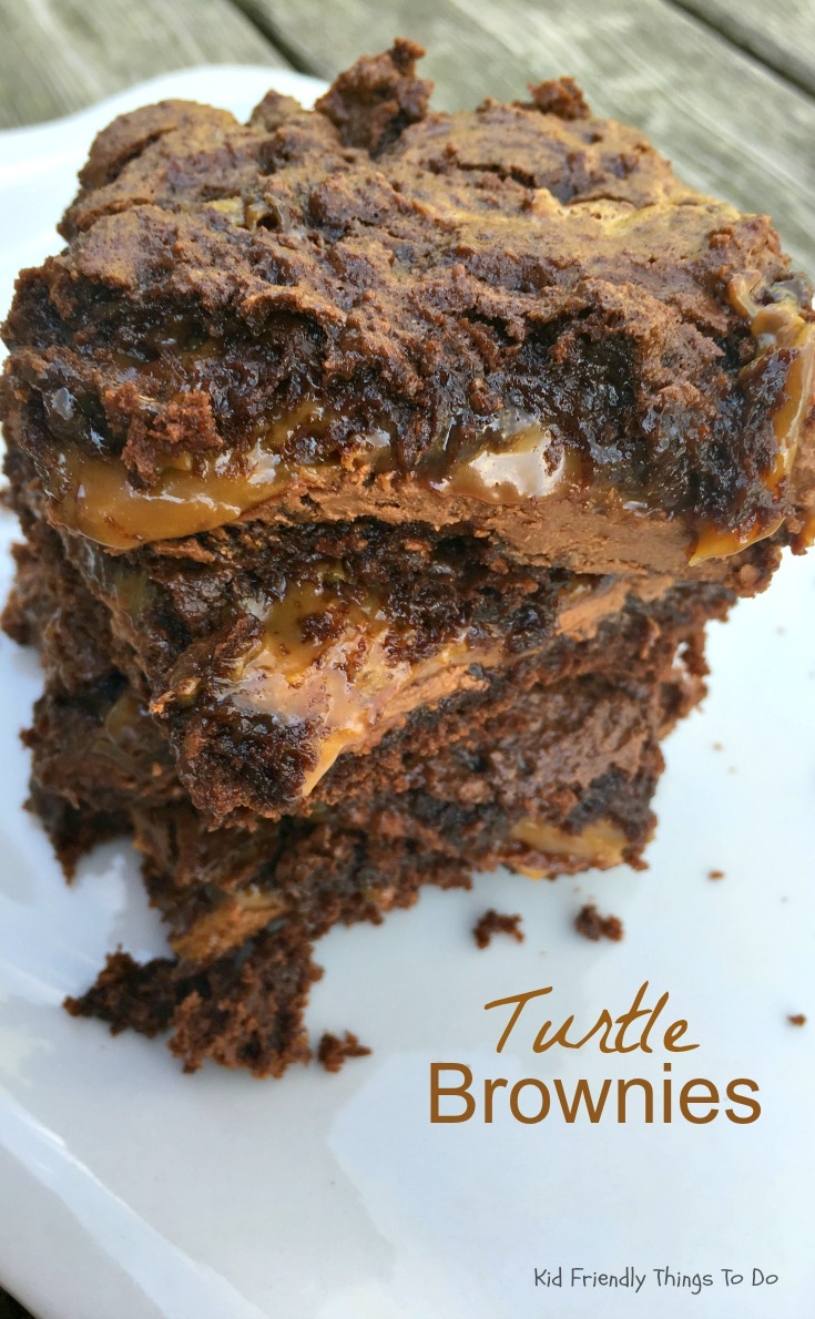 Chewy, Gooey, Loaded Turtle Cake Brownies - Easy to make. Oozing with caramel and tons of chocolate! The best! KidFriendlyThingsToDo.com