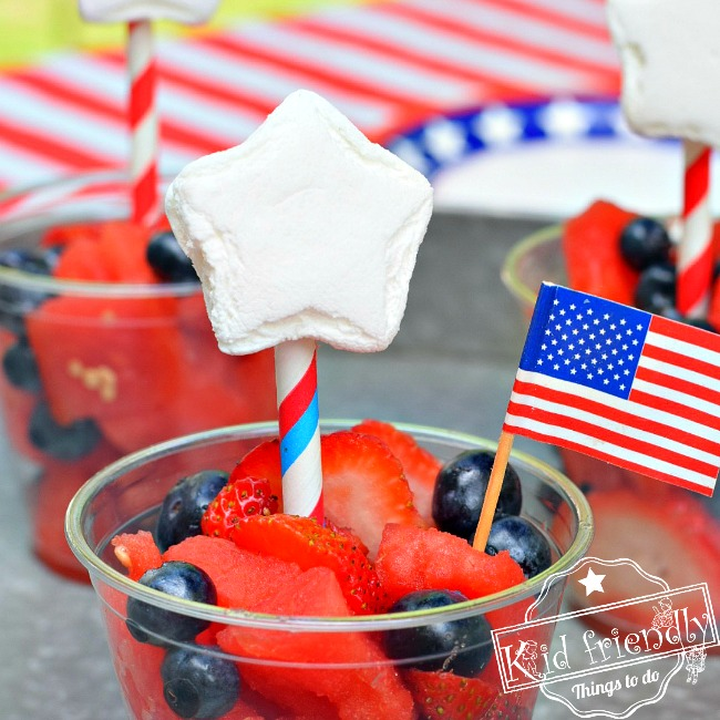 Red, White and Blue Easy to make Patriotic Fruit Salad in a watermelon bowl or cup. Great fun treat for the kids on Memorial Day, Labor Day, Fourth of July or summer picnic parties! www.kidfriendlythingstodo.com