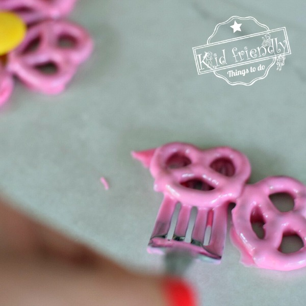 Setting chocolate covered pretzels out to harden
