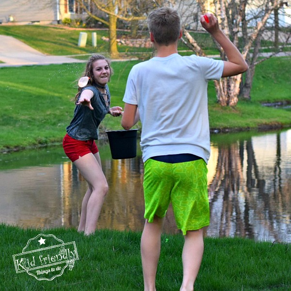 Playing a Water Balloon Outdoor Game for Kids