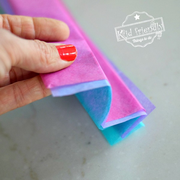 Folding tissue paper to make DIY flowers