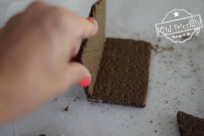 assembling a graham cracker house