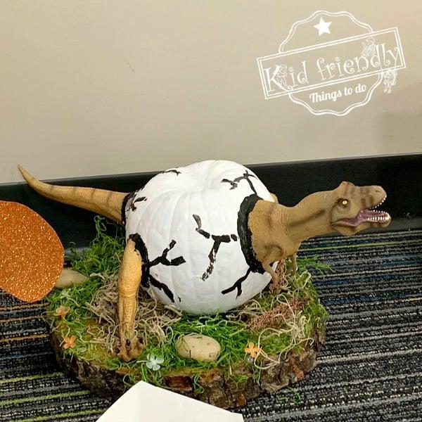 dinosaur hatching painted pumpkin